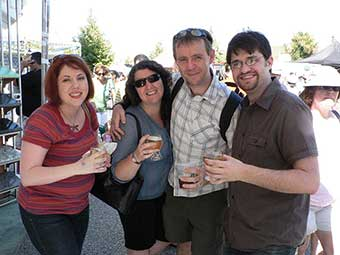 Enjoying festival wine and microbrews with friends