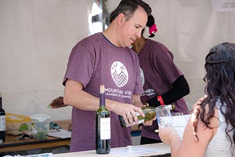 festival volunteers pouring wine