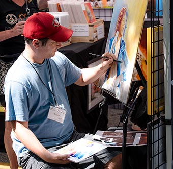 artist painting demo at the festival